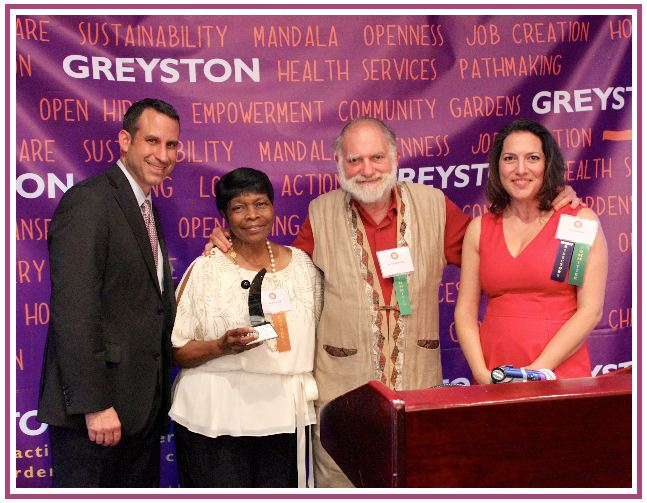 Jeff Koslowsky, CFO of Advocate Brokerage and Managing Member of Indigo Asset Management, Sarah Brown, Greyston Bakery employee, Bernie Glassman, founder of Greyston Bakery, and Ruth Suzman, member of the board of the Greyston Foundation, present the Bernie Glassman Pathmaking Award to Sarah Brown.